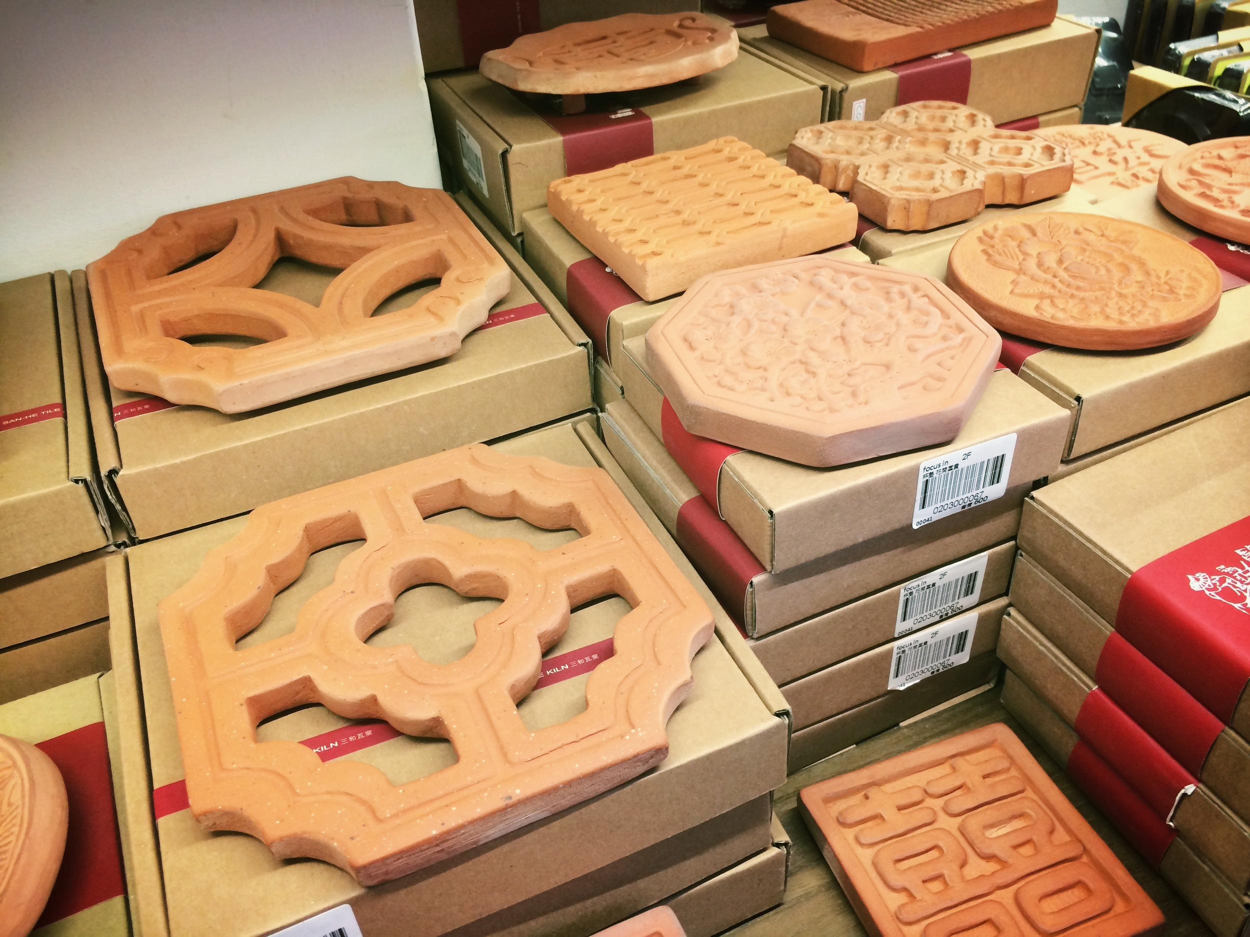Clay tiles. I bought one to use as a dish soap.