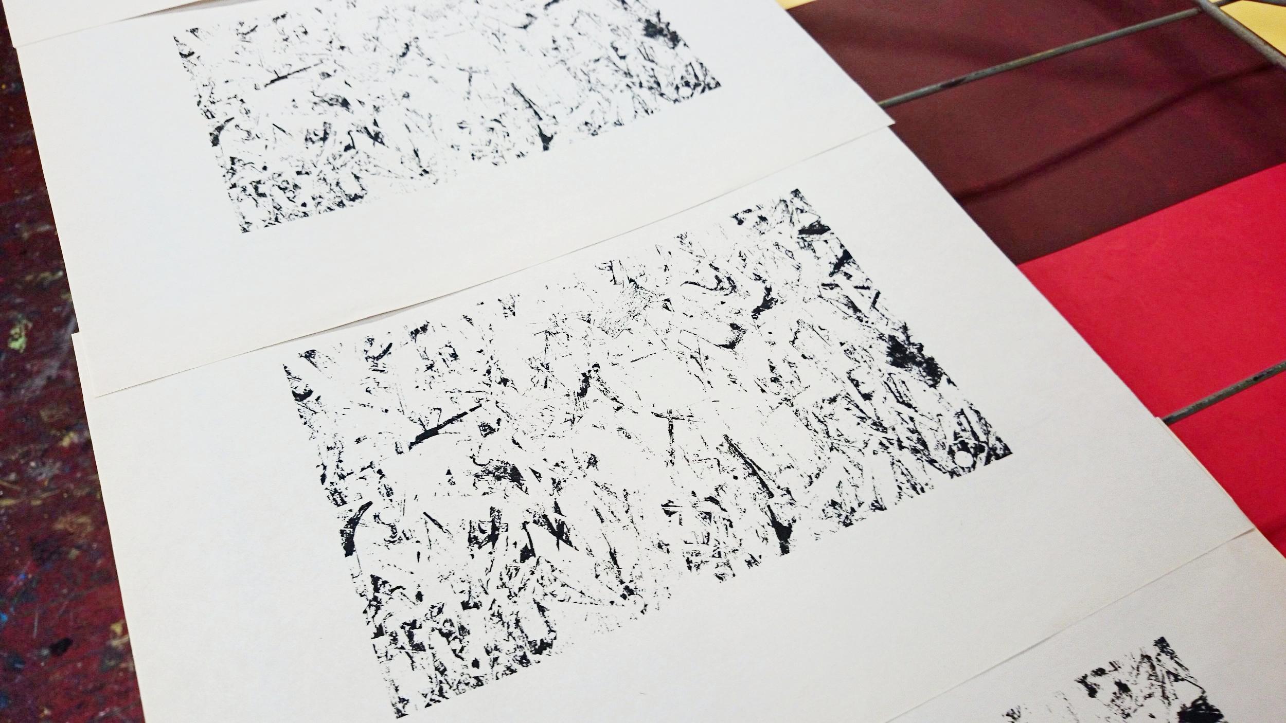 Layer 1 artwork in black printed on newsprint paper.