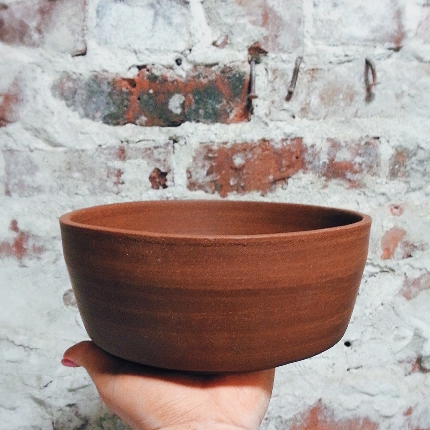Nesting bowls.Thrown, trimmed, smoothed.Ready for the first bisque fire. -