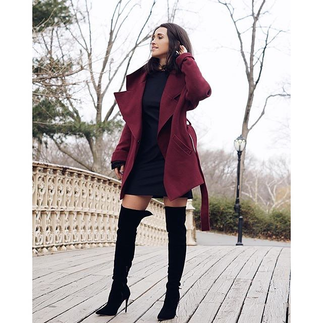 Loving Elma Beganovich's look here. She teams our black  knee high boots  with a simple turtle neck dress and rich burgundy waterfall coat