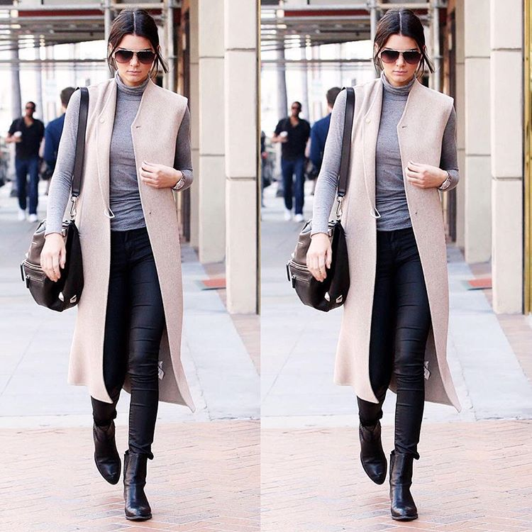 Kendall Jenner knows how to wear a camel coloured sleeveless blazer, pairing the look with those cigarette pants and  heeled boots