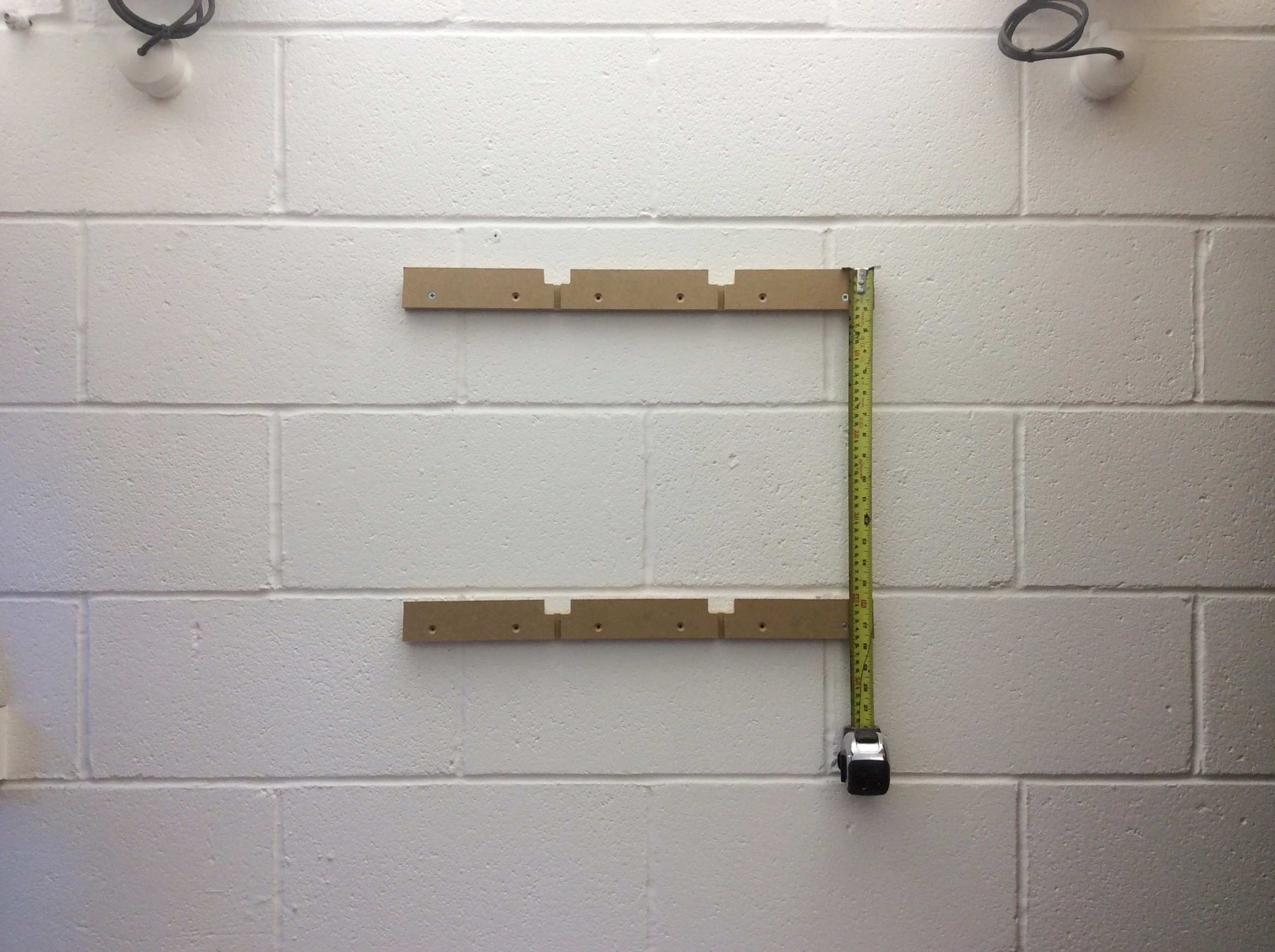 Set out next baton below, pilot hole first fix & then install first fixing then repeat for second fixing