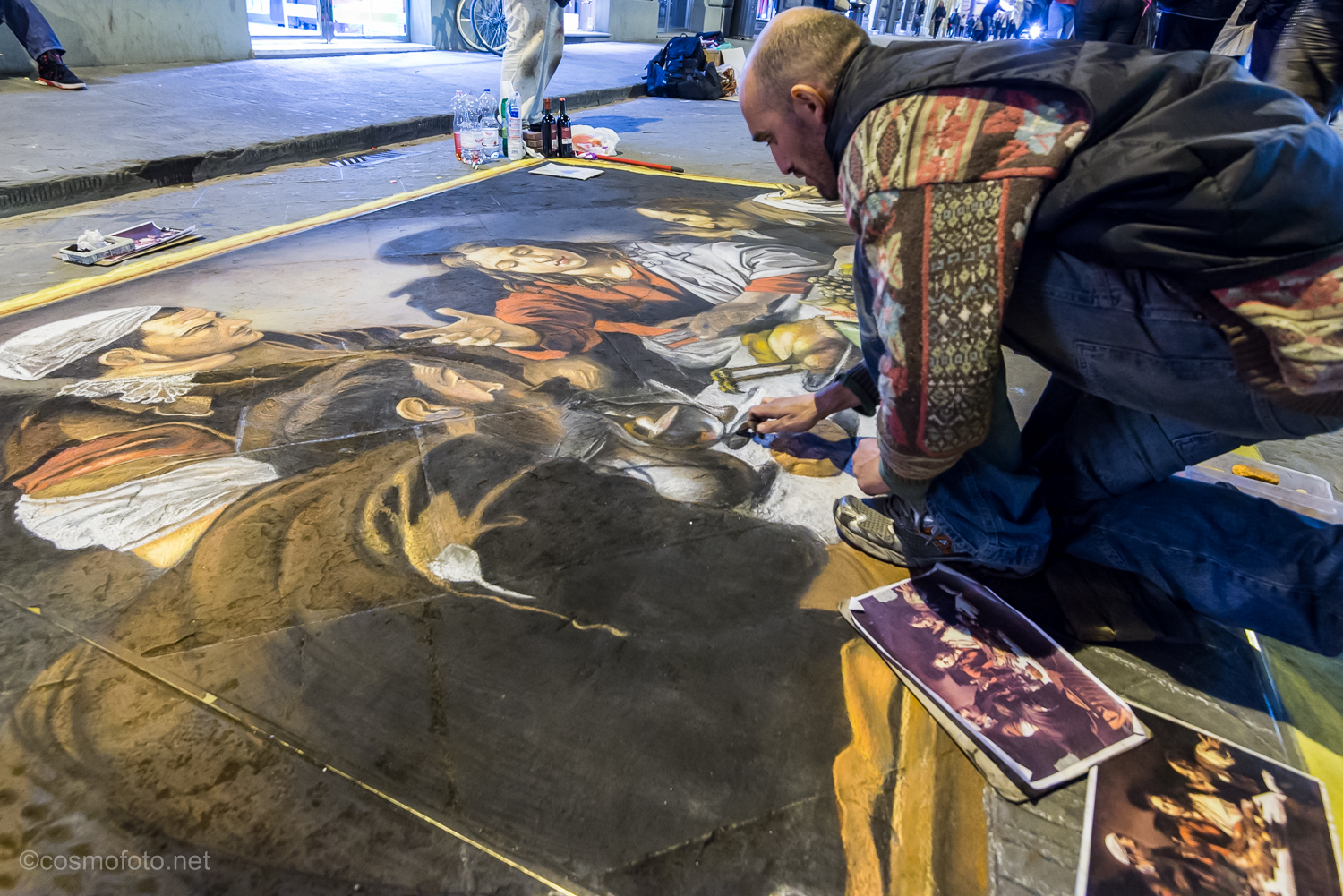 A street artist at work late at night