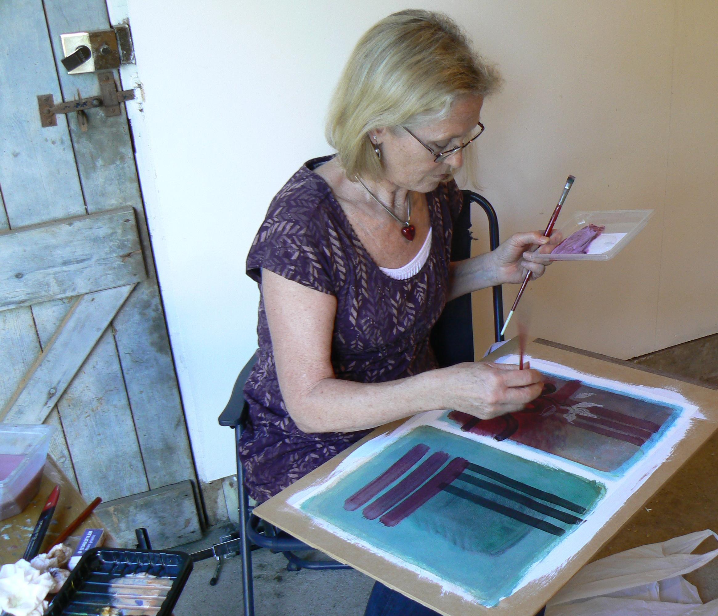 Sally starts painting.