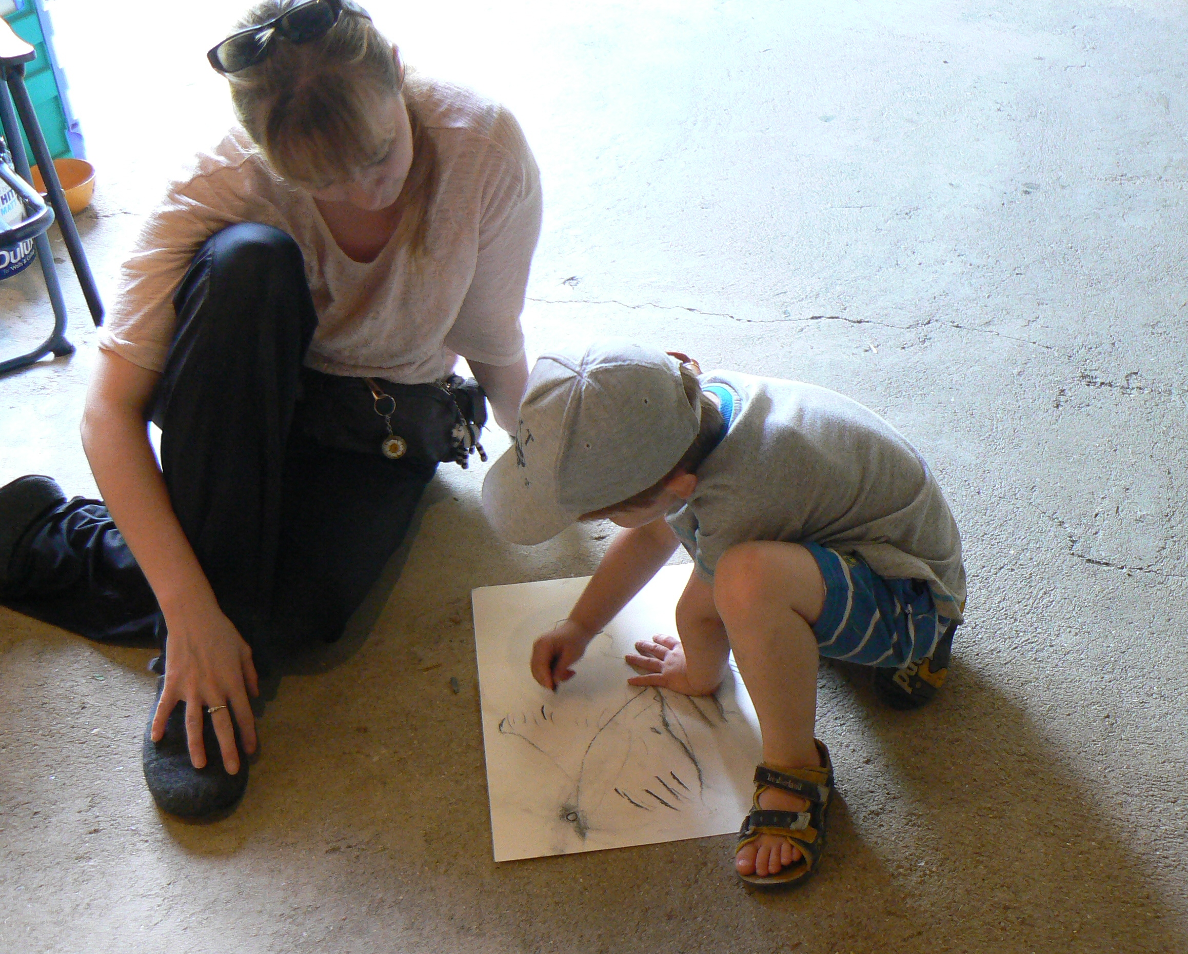 One of our younger visitors having a go with charcoal for the first time.