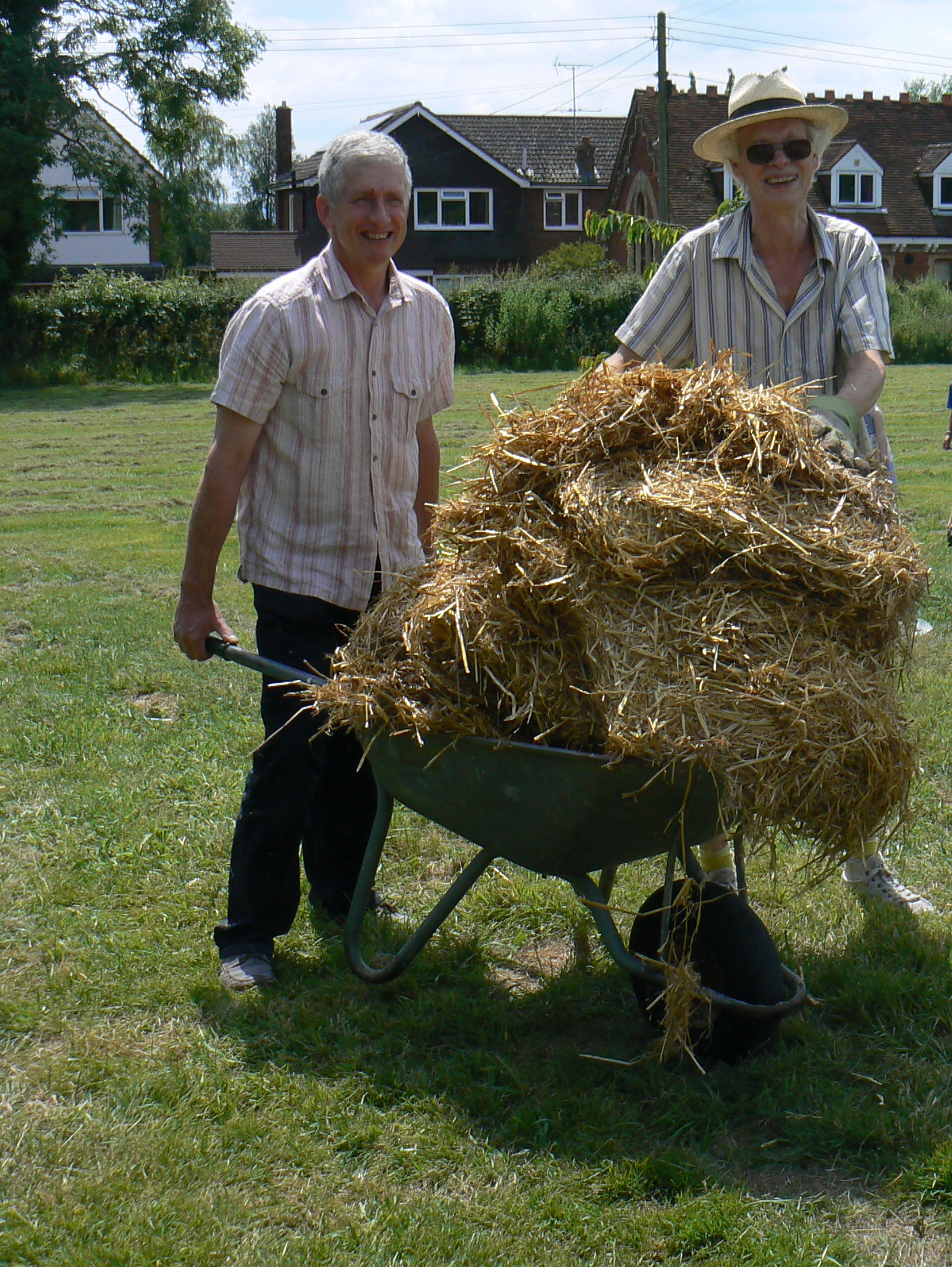 Peter and Tony with the straw in a squeaky wheelbarrow.