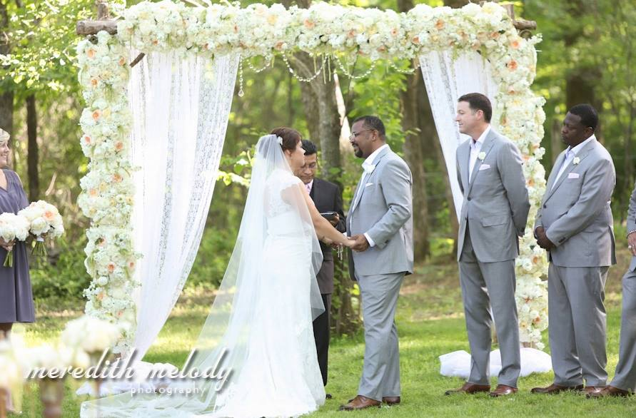 Meredith Melody Photography .  Ashley + Ivan 's wedding was over-the-top amazing! It was glamorous, elegant and everything a wedding should be. Their flowers were dripping with crystals, and the Latin-inspired details throughout their decor were beautiful!