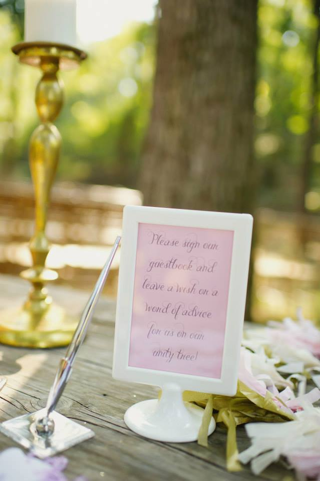 Melissa McCrotty Photography . At  mine + Richard 's wedding, we asked our guests to leave a word of advice or a wish for us on a little tag and then hang it on our unity tree, which we watered during our ceremony!
