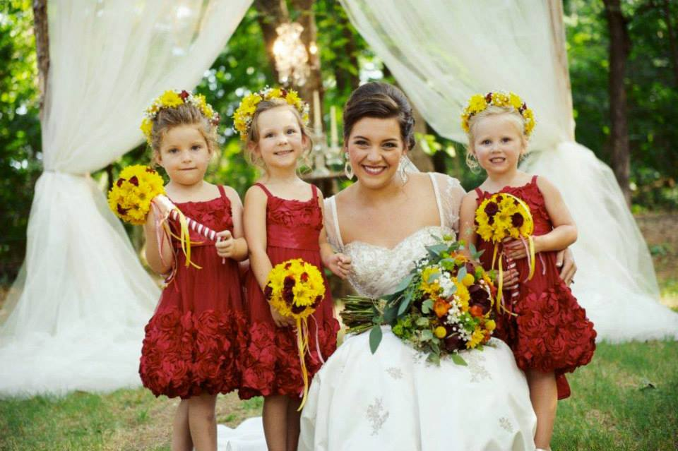 BnBauman Photography, from  Chelsea + Logan 's wedding at The Barn. These tiny flower girls in yellow flower crowns? Almost too much cute for me to handle.