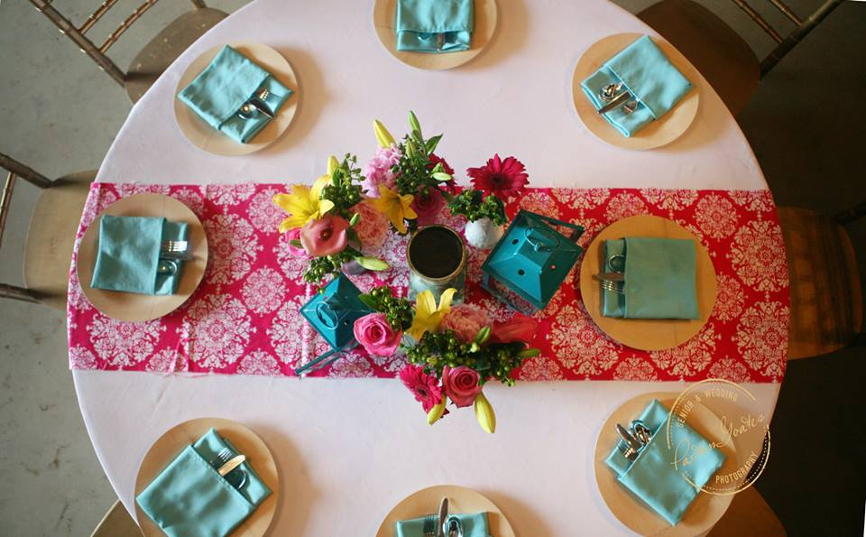 Paxton Goates Photography , from  Carla + Mark 's wedding at The Barn. The table runner is the perfect place for a pop of pink!