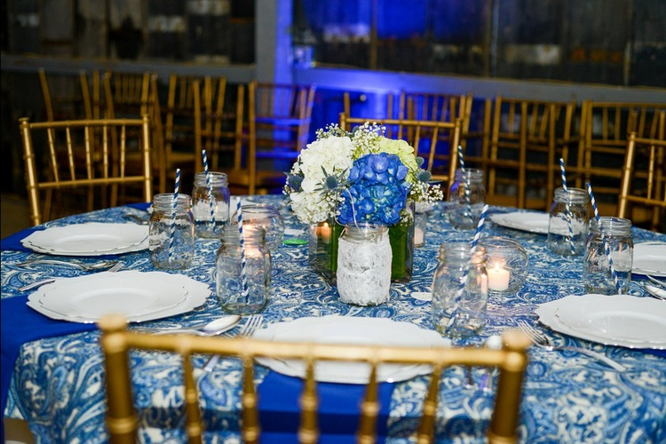 Tryston Hines Photography , from  Cara + Brock 's wedding at The Barn. These blue paisley tablecloths were the inspiration behind the whole look of this wedding!