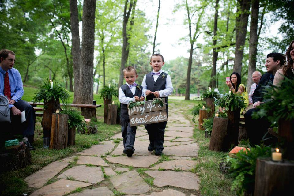 "Pictures by Katie .  Kelsey + Gueorgui 's ring bearers' sign said ""Hurry up, I want cake!"" How cute (and true) is that?!"