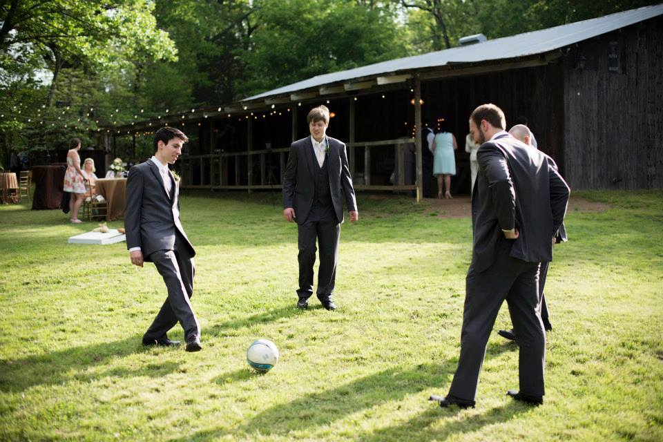 Pictures by Katie , from  Kelsey + Gueorgui 's wedding. This couple loves soccer, so the groom and his guys played a game during the reception!