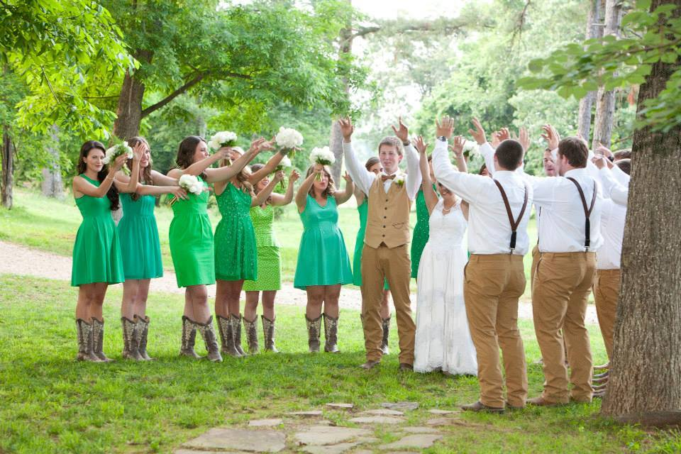 Kimberly Brackins Creative Portraiture , from  Jaclynn + Tyler 's wedding. This bride and groom both went to the University of Arkansas, so it only made sense for them to  call the Hogs  with their bridal party after the reception. Woo pig sooie to that! Also, they're both obsessed with green, which showed throughout their decor.