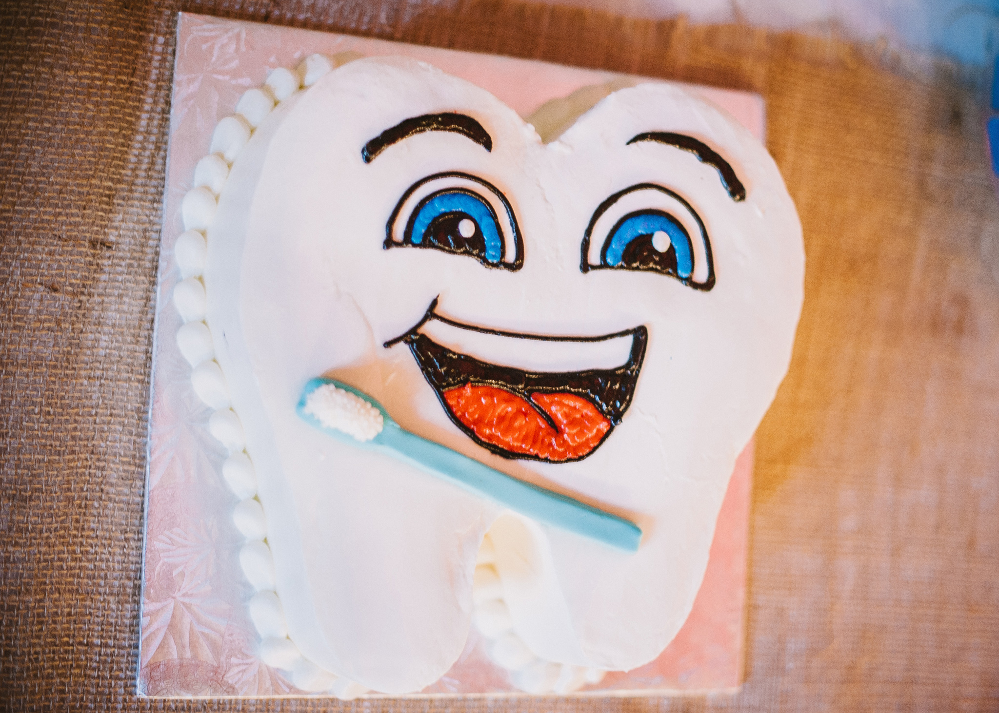 BnBauman Photography , from  Chelsea + Logan 's wedding. Logan was in dental school at the time of his wedding, so this precious tooth groom's cake was a must! He and his bride also gave toothbrushes and floss as favors.