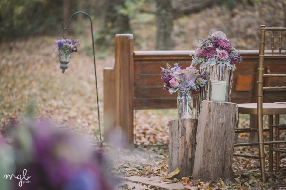 MGB Photo , from  Meagan + Alex 's wedding at  The Barn . Purple floral arrangements (with lots of texture!), logs lining the aisle, a stunning burlap altar & fallen leaves... this is one of my favorite fall weddings ever, hands down.