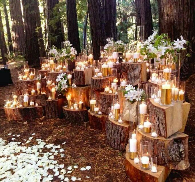 Decozilla . This altar set-up might be a little bit overkill, but I love it anyway. Logs + romantic candlelight... simple and perfect for an evening ceremony!