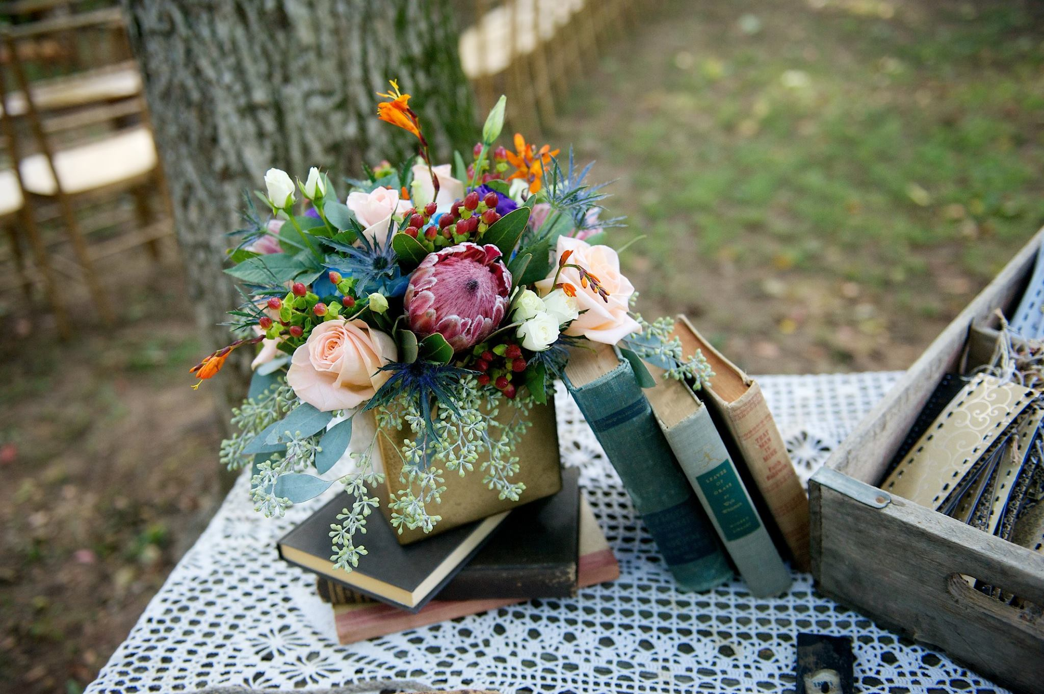 Danielle Davis Art/Photography , from  Emily + Blake 's wedding at The Barn. Protea always makes a statement!