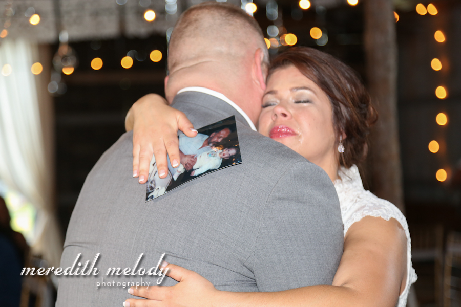 Meredith Melody Photography , from  Ashley + Ivan 's wedding. During their father-daughter dance, Ashley's stepdad pulled out a photo of her with her real dad, so she could share the dance with him, too. SO sad, SO sweet!!!