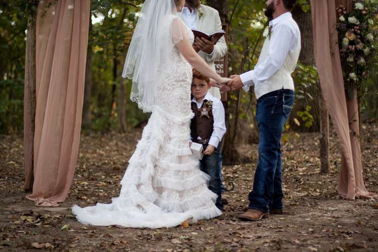 "Southern Belle Snapshots , from  Erin + Scott 's wedding. This sweet boy just wanted to be close to his mama. And you can't see in this photo, but the badge on his shirt says ""Ring Security."" How cute!"