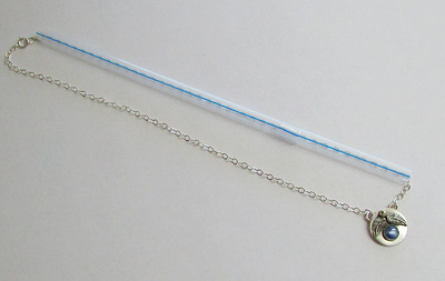 Thread a necklace through a straw