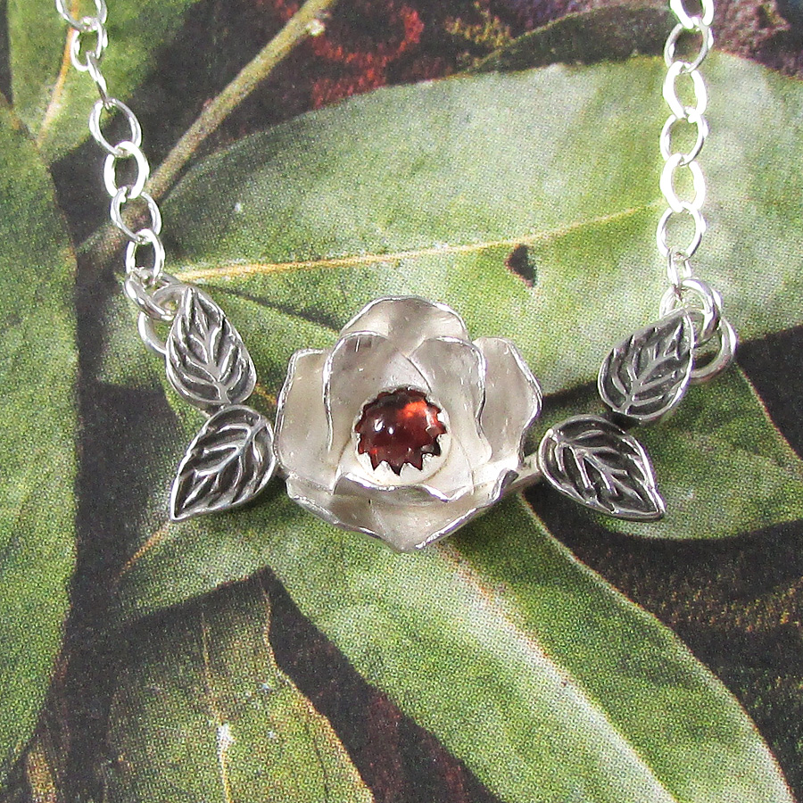 Sterling silver rose necklace with garnet