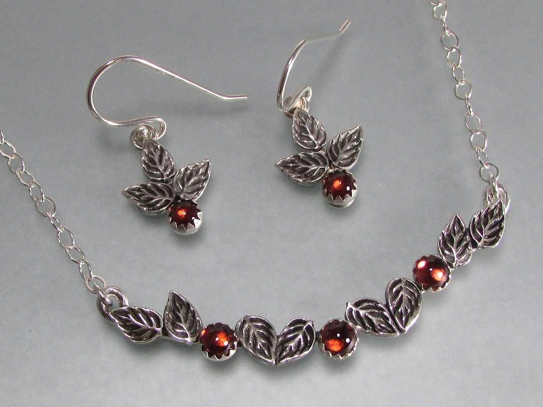 Rose leaf necklace with garnets and matching rose leaf and garnet earrings