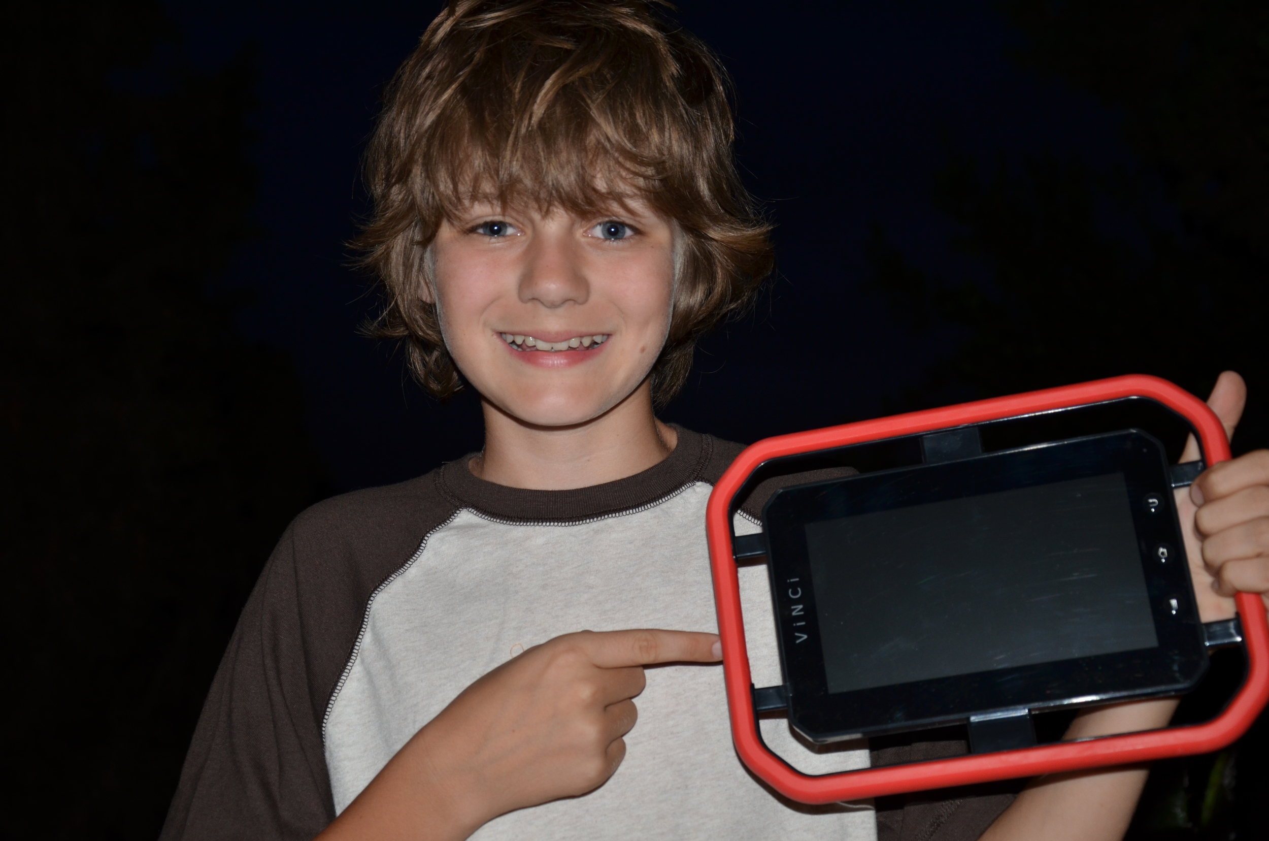 """Iron Man 3  star Ty Simpkins (""""Harley"""") posing with the Vinci tablet"""