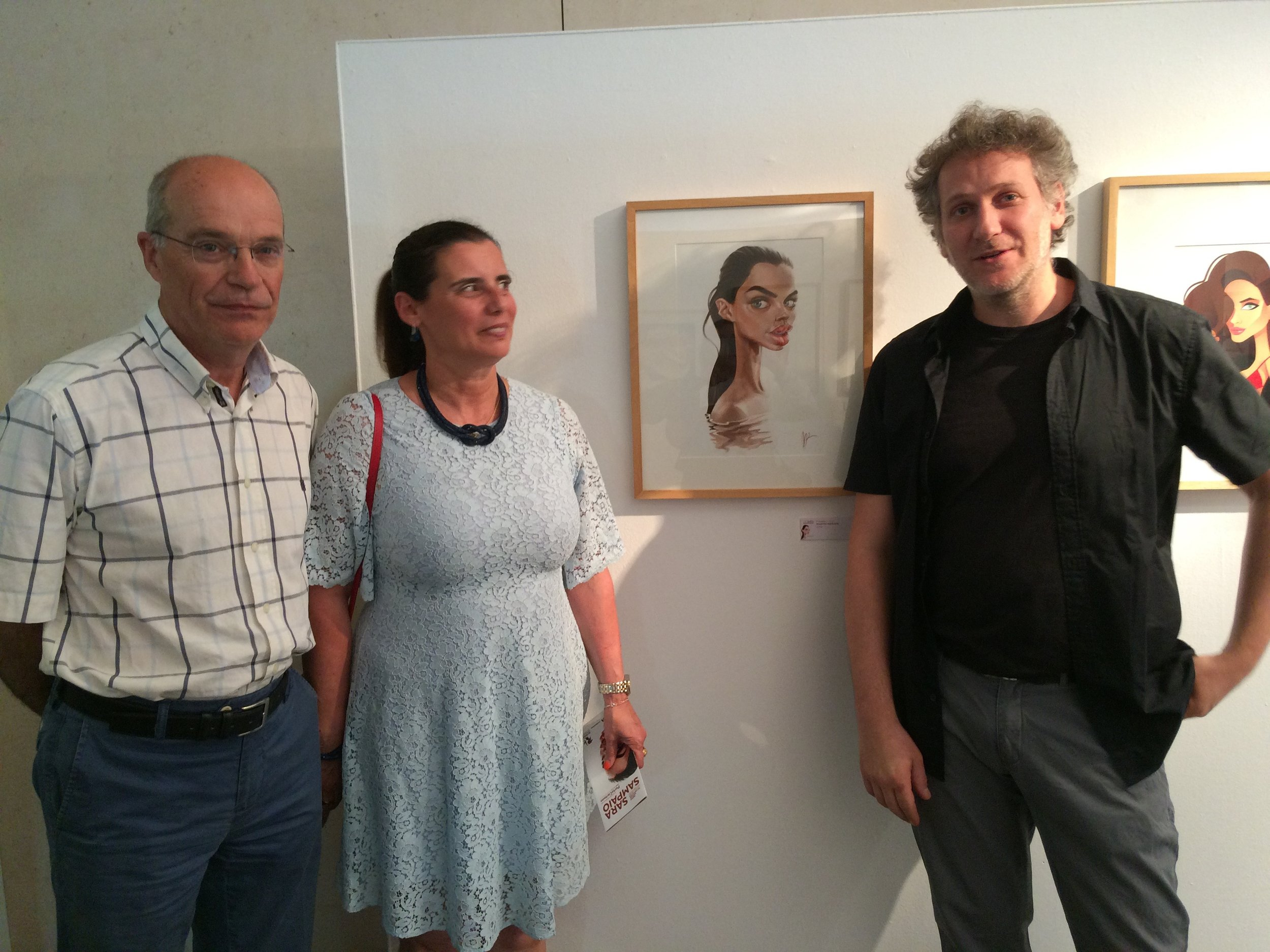 Sara Sampaio's parents and Marzio Mariani (author of the caricature) in front of the artwork that won the First Prize for the caricature contest at the PortoCartoon Festival 2016.