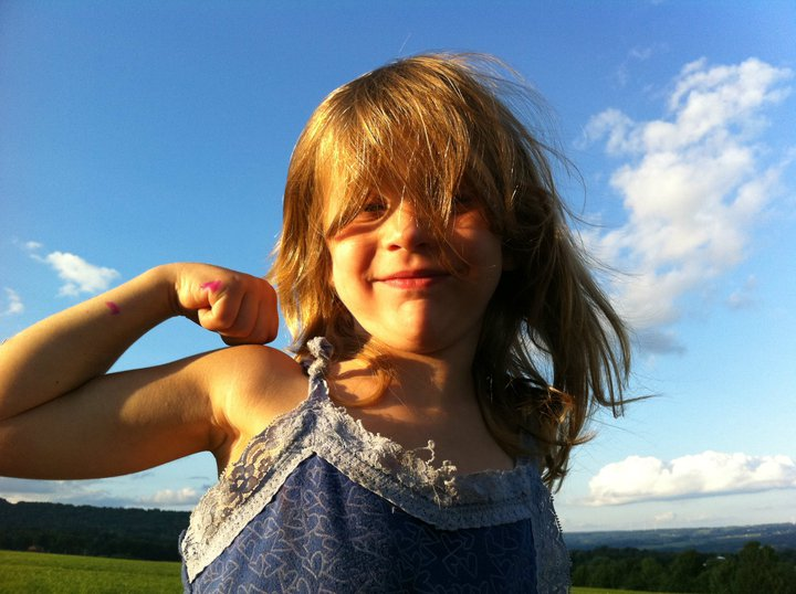 Margaret shows off her farm-girl muscles!