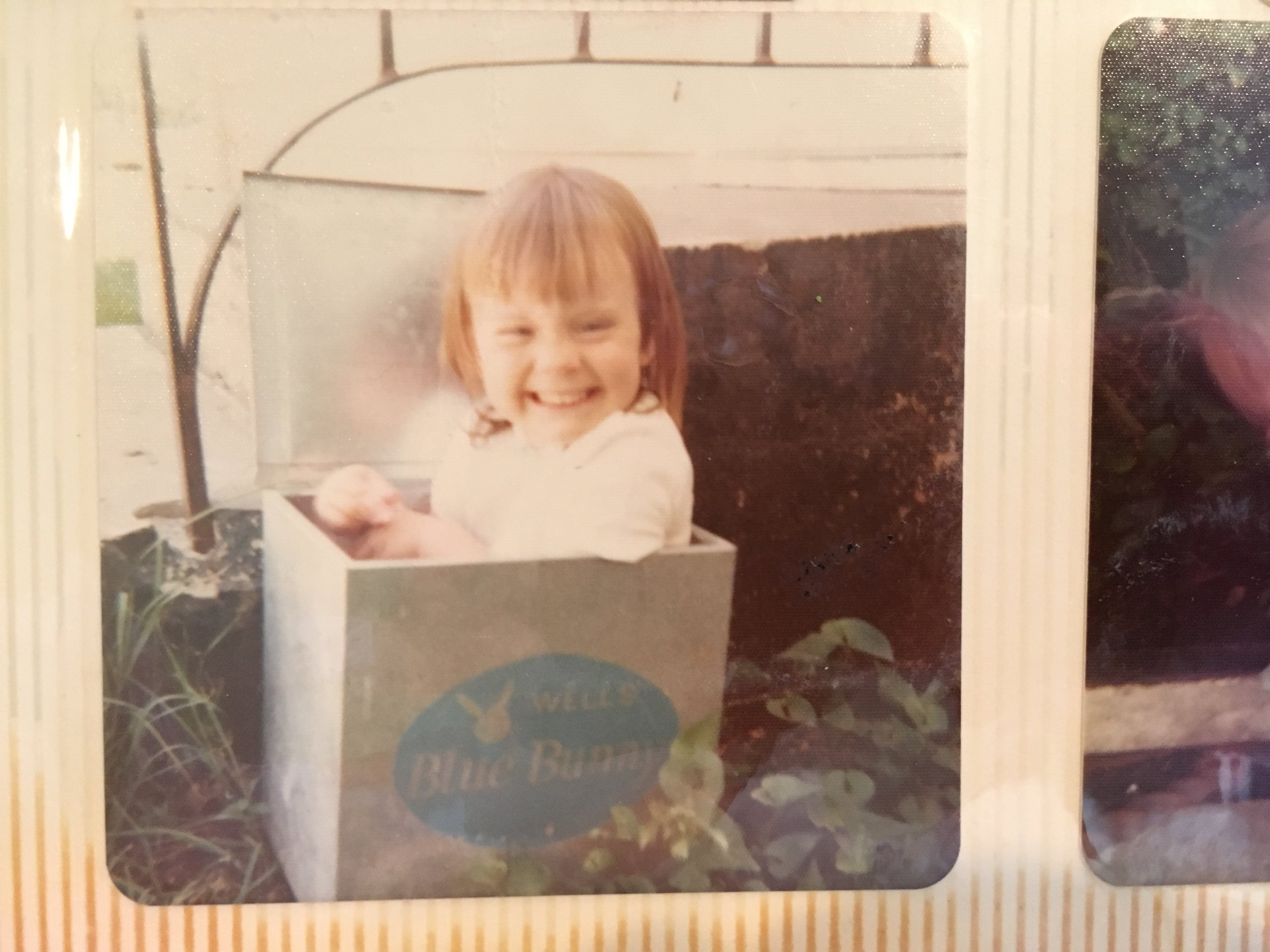 Me, fitting snugly into the milk box, circa 1973.