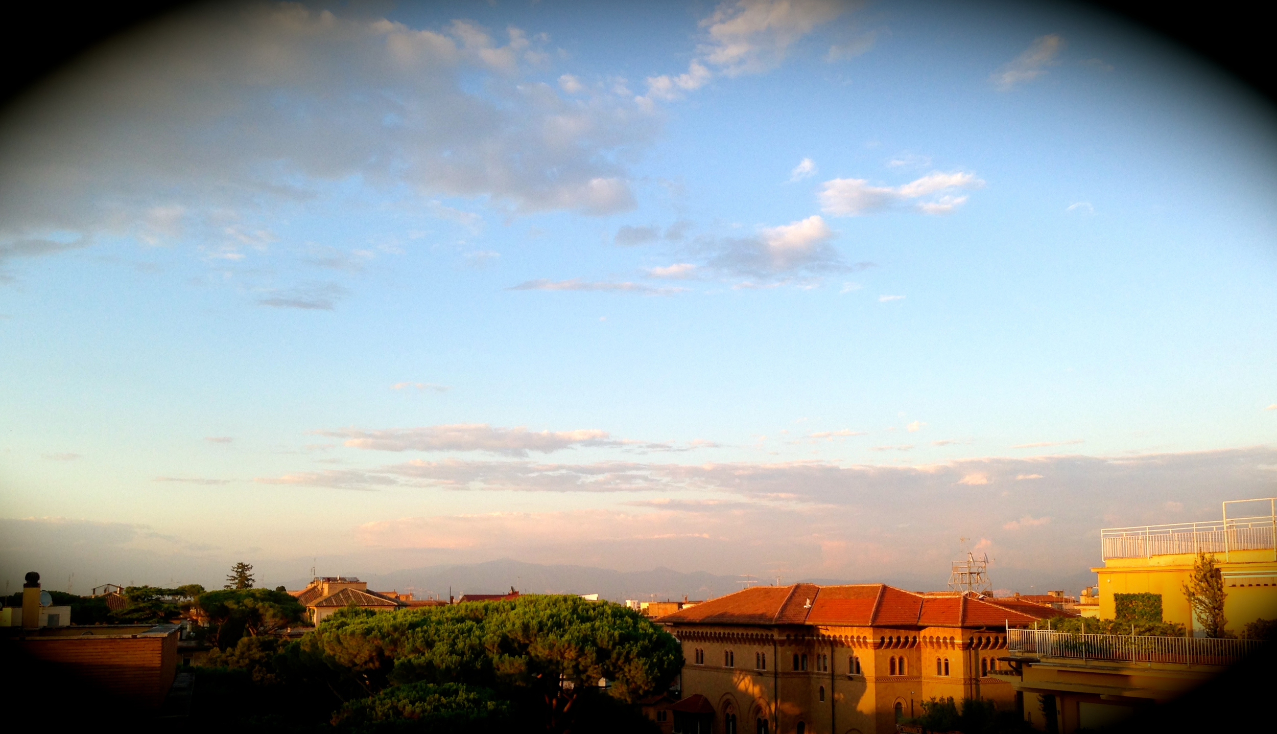 The view from my apartment building's rooftop, which sums up what I've seen of Rome thus far.