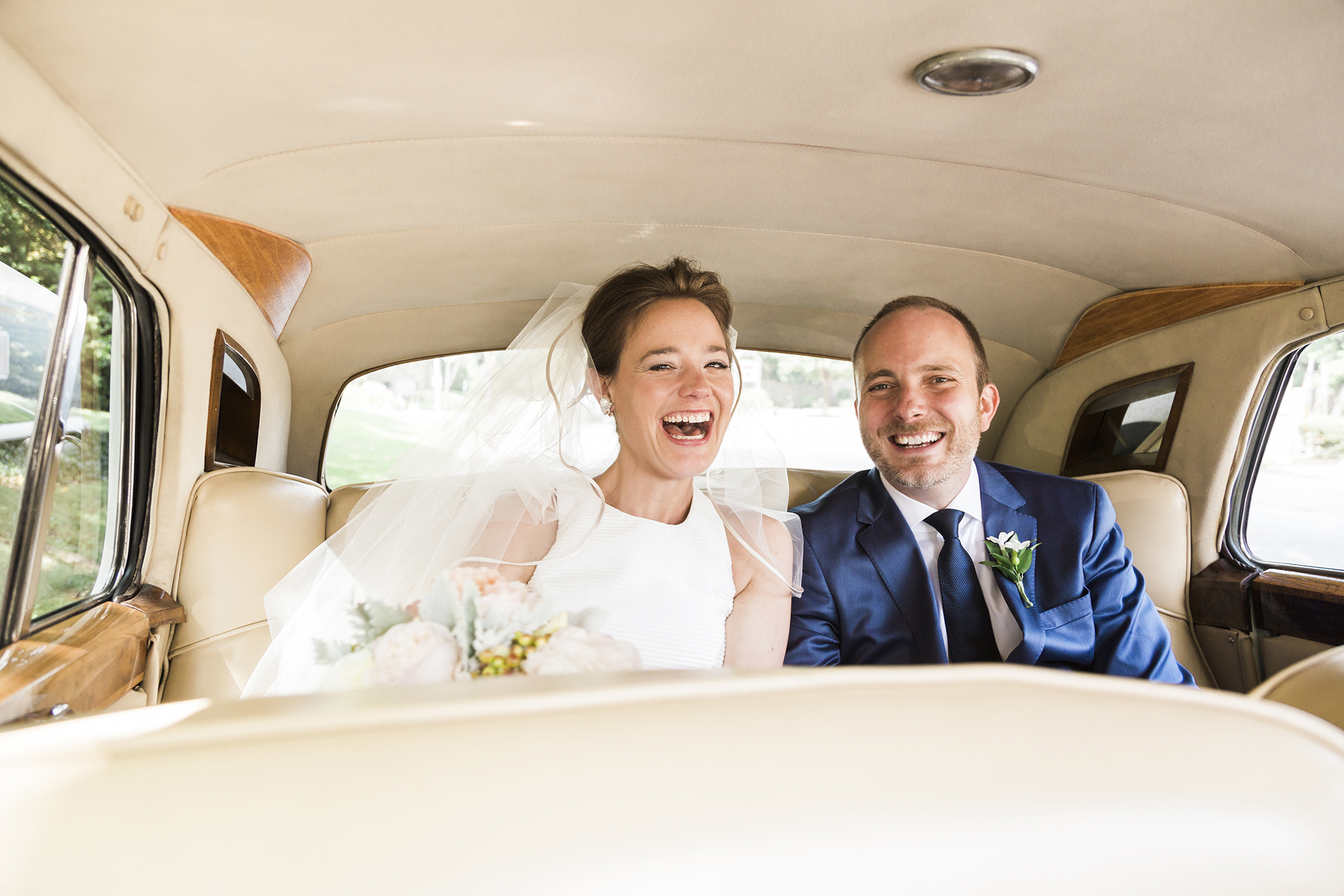 Courtney and Dave arrive at the reception in a vintage Rolls Royce. Photographed By Hudson-Nichols Photography.