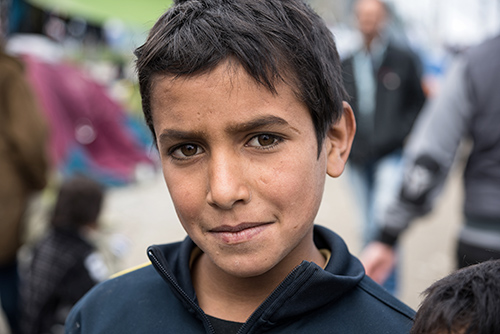 © Dinosmichail | Dreamstime.com -  Boy In Refugee Camp In Greece Photo