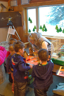 And there were kids, kids and more kids. They were learning about all of the birds being presented. Here Karen is demonstrating bird calls and why they do them.