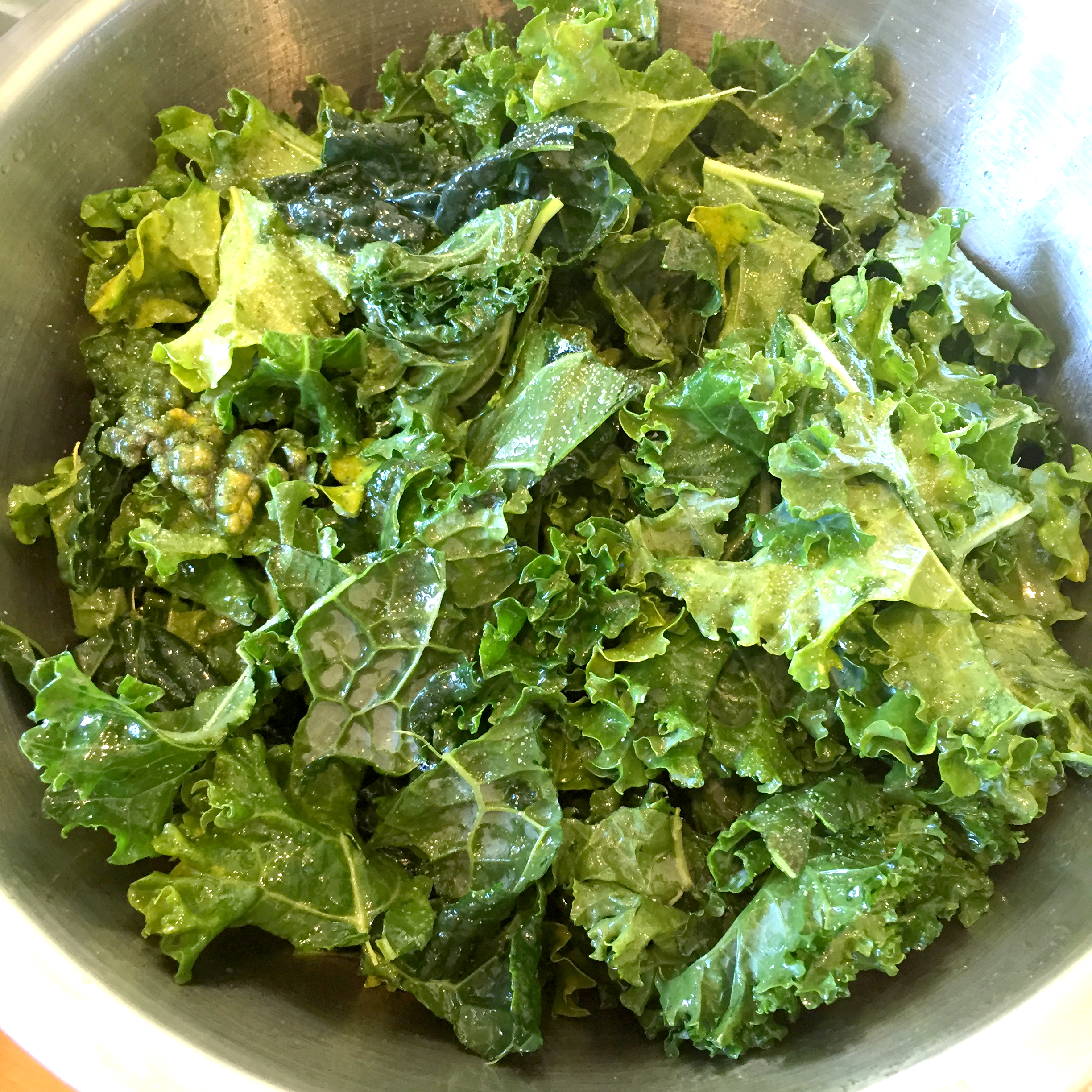 Prepared kale leaves for making kale chips.