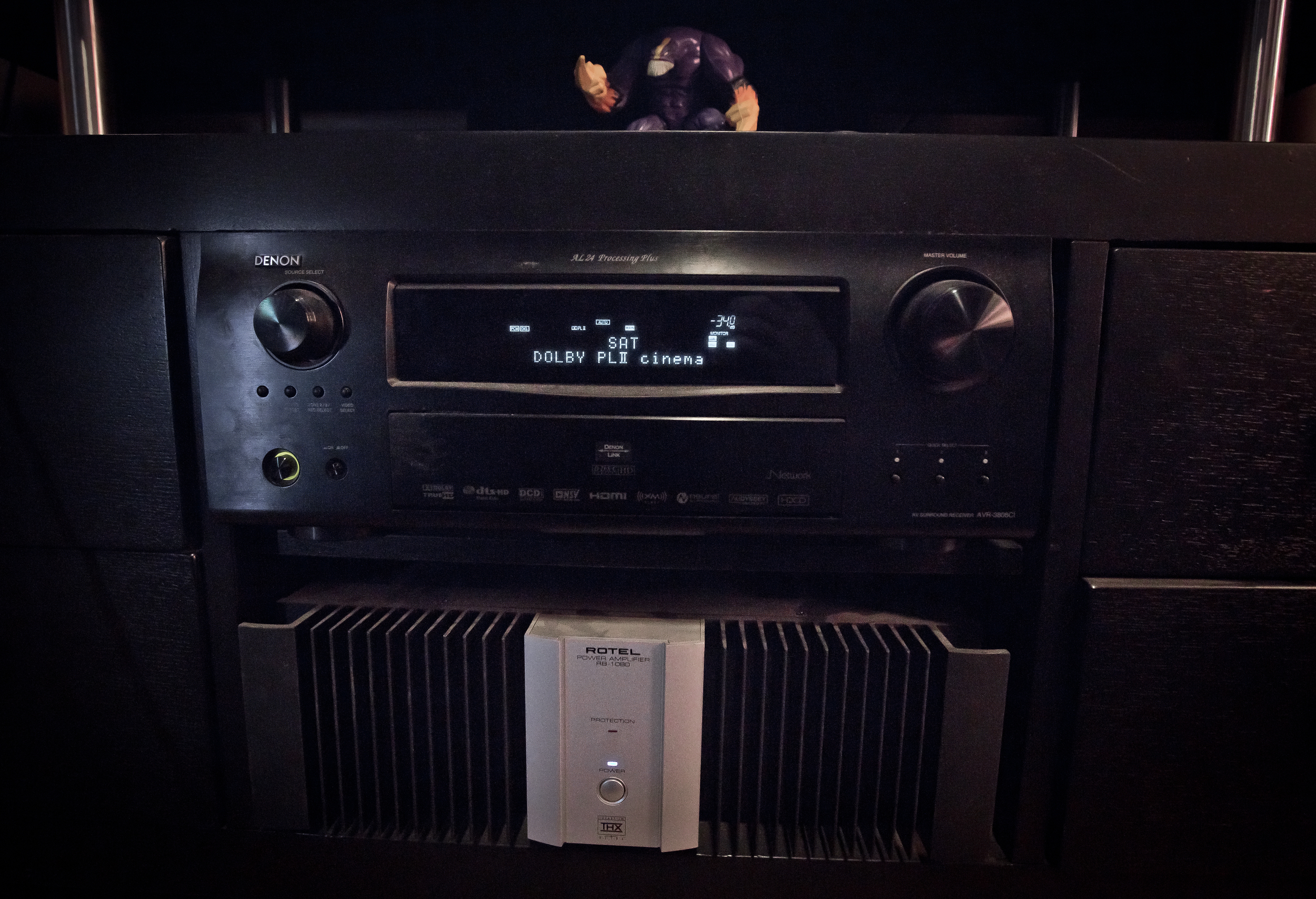 """Denon Receiver and Rotel Amp. Also """"The Maxx"""" action figure standing guard."""