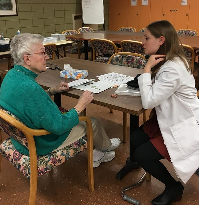 Possible hearing aid options are explained to resident Rosie Yaksh.