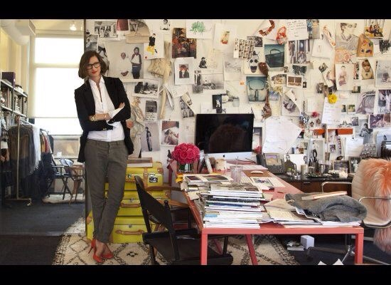 Jenna Lyons in her office surrounded by inspiration (power stance of course)