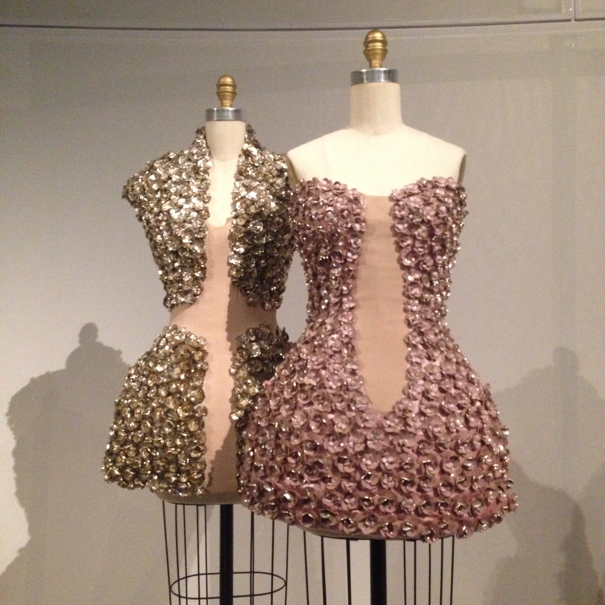 Alexander McQueen dresses with metal flowers and synthetic pearls.
