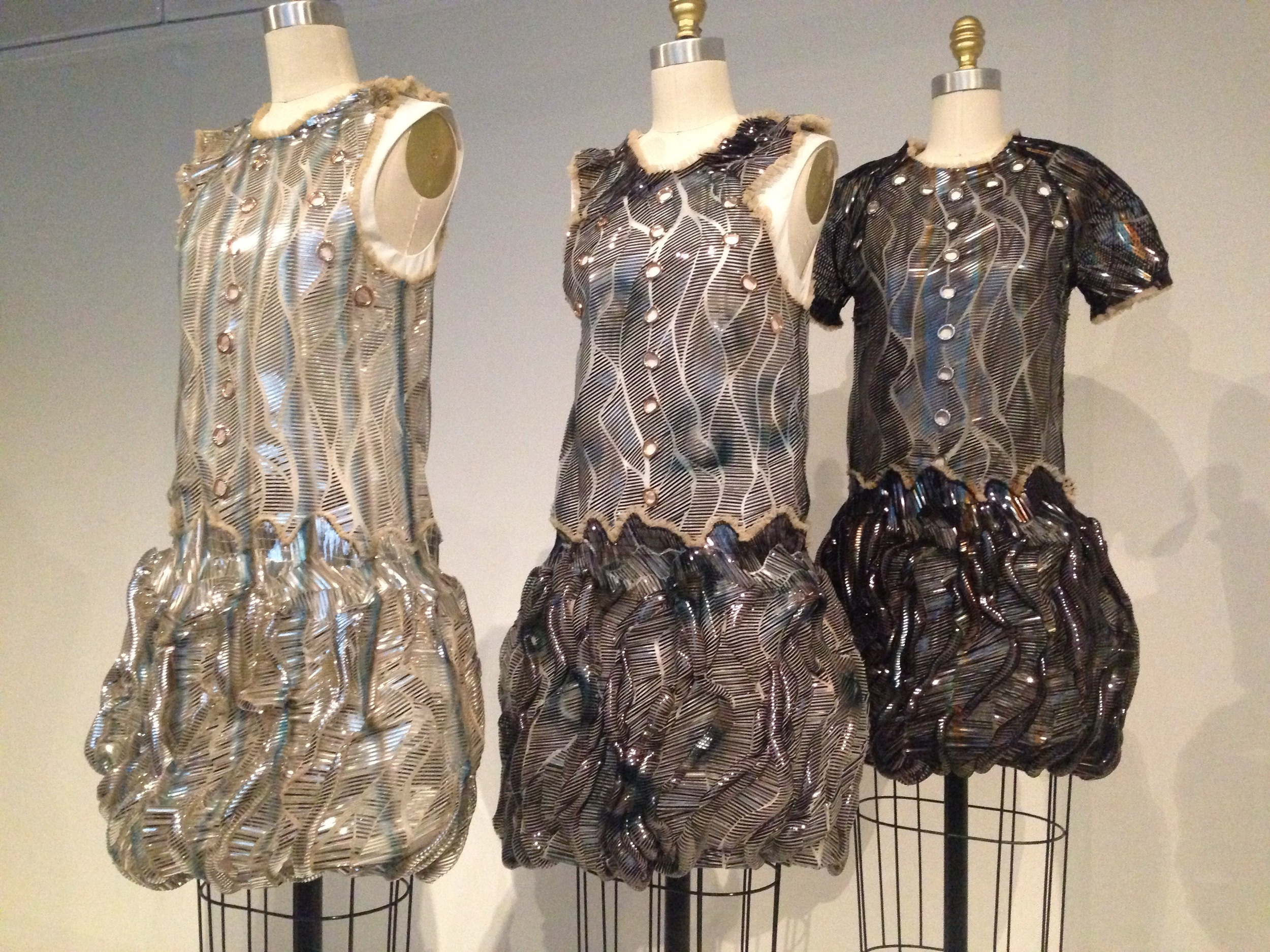I forget the designer of these dresses. I do love the metallic accents and textures.