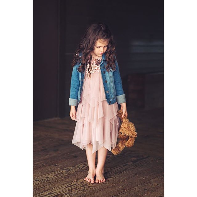 Miss @audrina_grace and little friend. Love the moody feel of this one. Dress: Biscotti