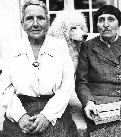Stein (left) and Toklas (right) with their dog.