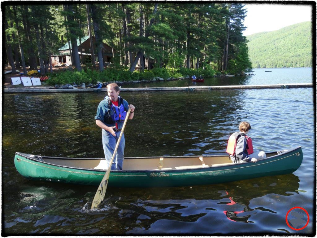 """John Meader showcasing his stand-up paddling skills at Maine Canoe Symposium. """"Why? Well, in part because I'm too cheap to buy a SUP board!"""""""