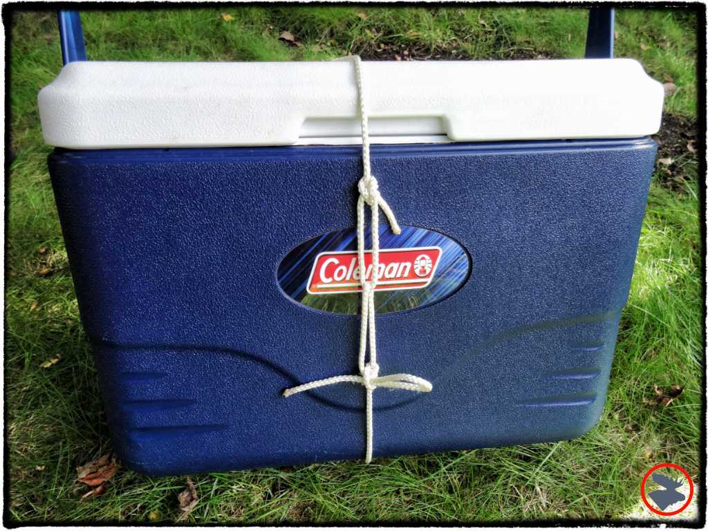 The bowline rope tackle works really well for securing cooler or wannigan lids. Top knot is a bowline. Rope is run around cooler, up through bowline, and then tied tightly against itself with a slippery taut-line hitch for quick release.