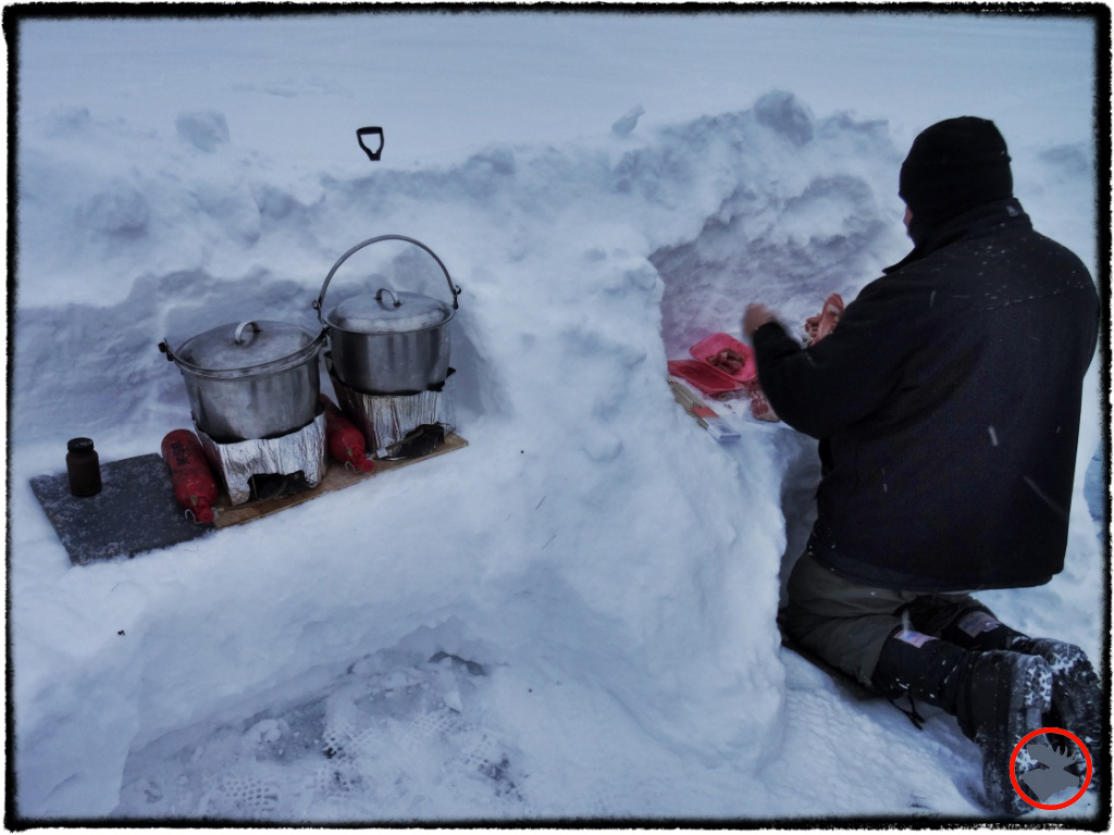 A DIY snow kitchen cankeep your gear organized and help block wind.