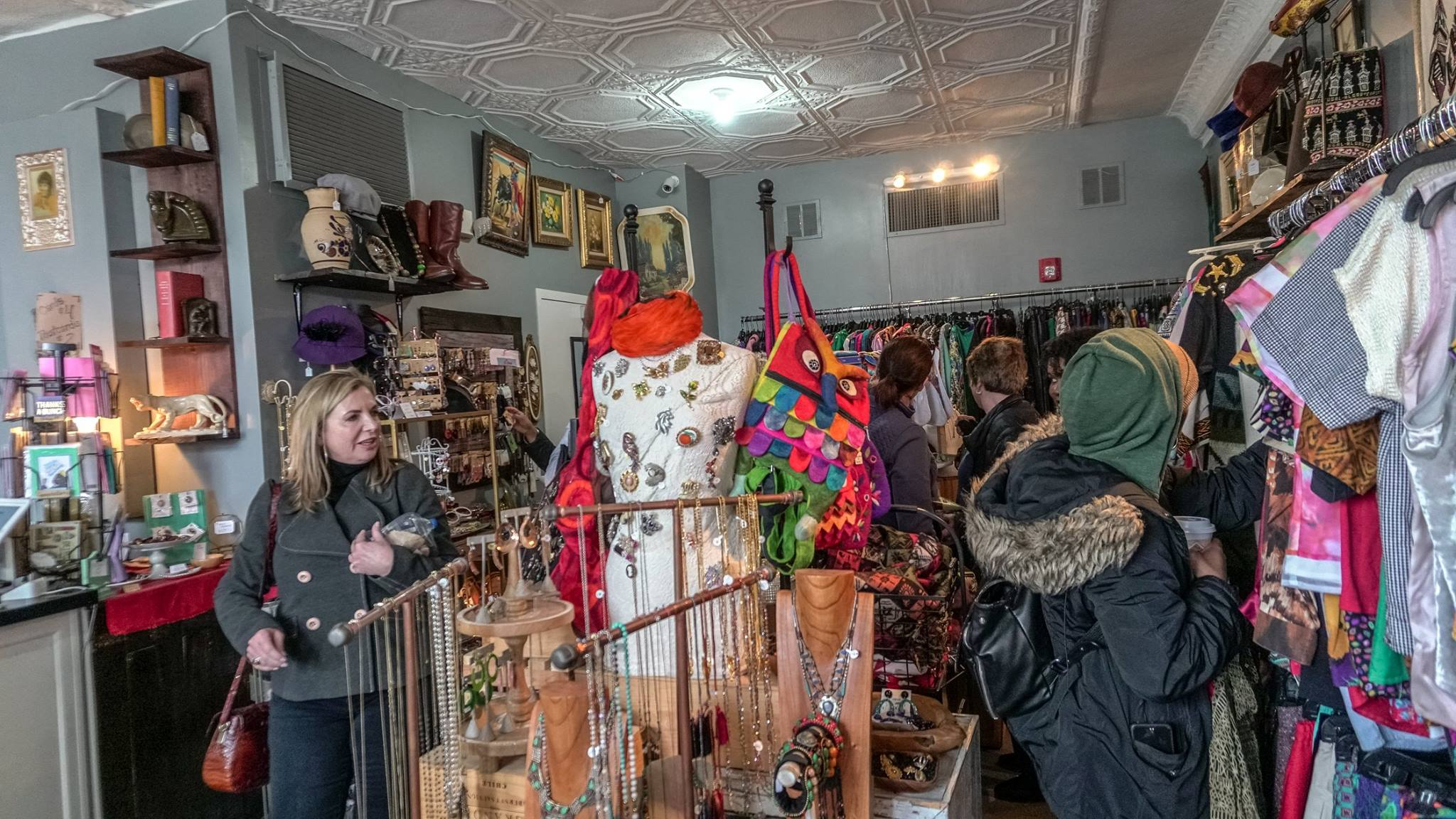 DXF tour participants exploring the groovy and unique Mama Coo's boutique on our Corktown walking tour