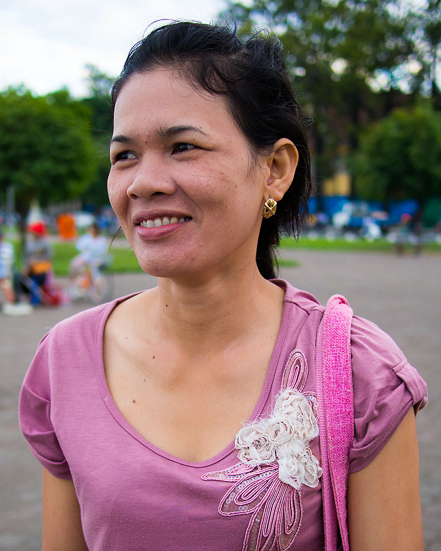 """""""I moved to Phnom Penh three days ago to find work. I work sewing garments, but I don't like my job. I wish I could work in the market, selling things.""""   """"Do you like Phnom Penh?""""   """"No. I miss my home. I miss my mother. I wish I could be home with my mother.""""  — Im (Phnom Penh, Cambodia)"""