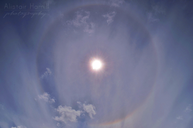 A 22 degree halo during the day . This was the first time I photographed this phenomenon. You can clearly see the rainbow like colours in parts of the ring.