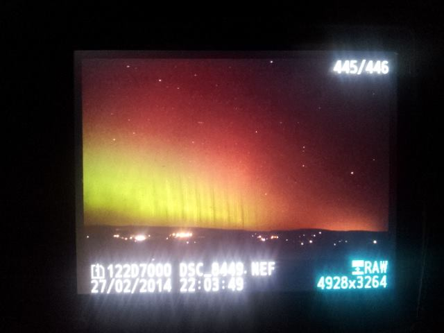 A phone shot of what appeared on my camera screen during the February 2014 display. This was only a 2 second exposure on my camera! This exceptional display was more than bright enough to see, even from inside the car with all the dashboard light as we drove north. But even in this case, the colours were not visible to the naked eye.
